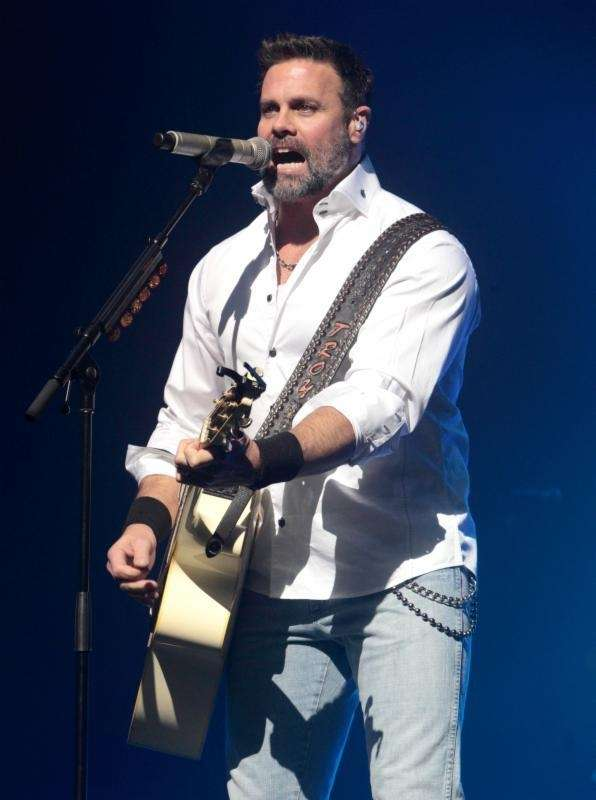 The official website for Montgomery Gentry says Troy