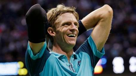 Kevin Anderson reacts after beating Pablo Carreno Busta