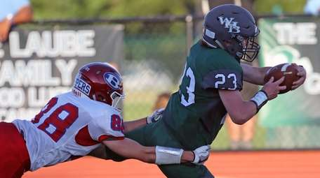 Westhampton's Tyler Nolan #23 dives for a touchdown