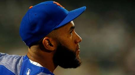 Mets shortstop Amed Rosario looks on against theReds