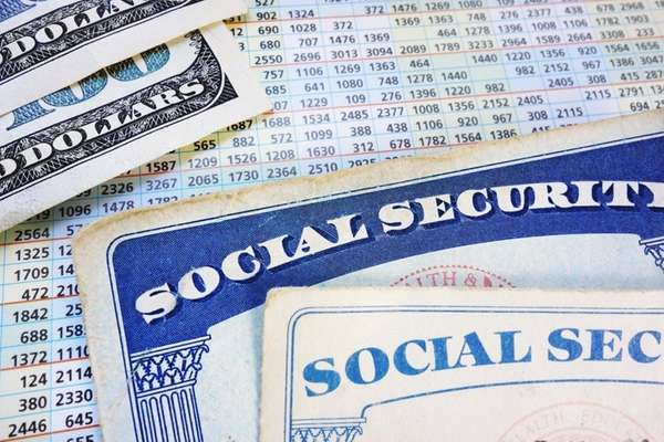 Social Security cards with cash and benefit amount
