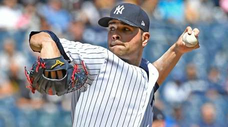 Jaime Garcia pitches against the Indians at Yankee Stadium