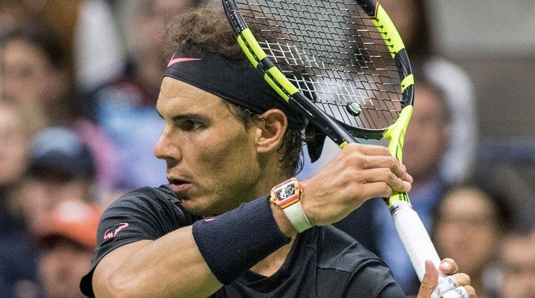 Rafael Nadal hits a forehand against Juan Martin