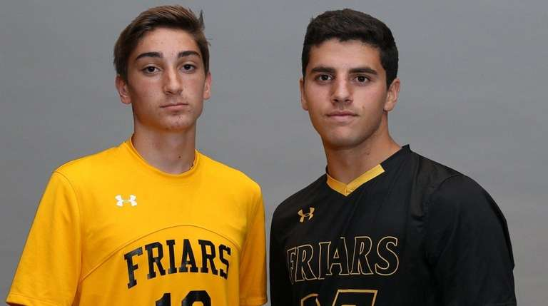 St. Anthony's soccer players Robert Leamey, left, and