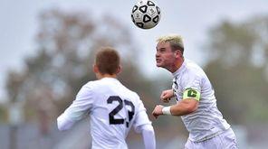 Hicksville's Matthew Sloan (15) heads the ball against