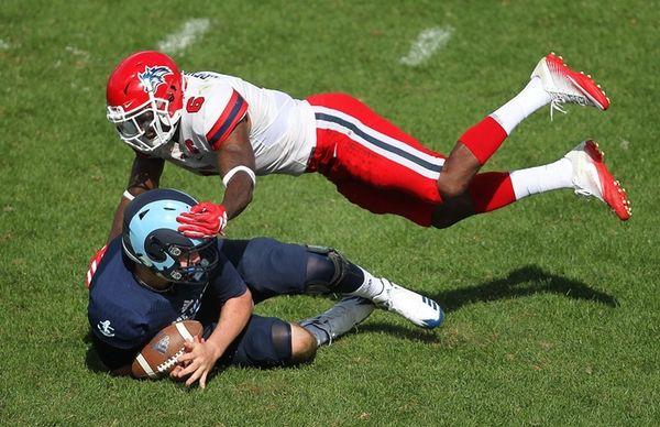 URI quarterback Tyler Harris recovers a fumbled snap