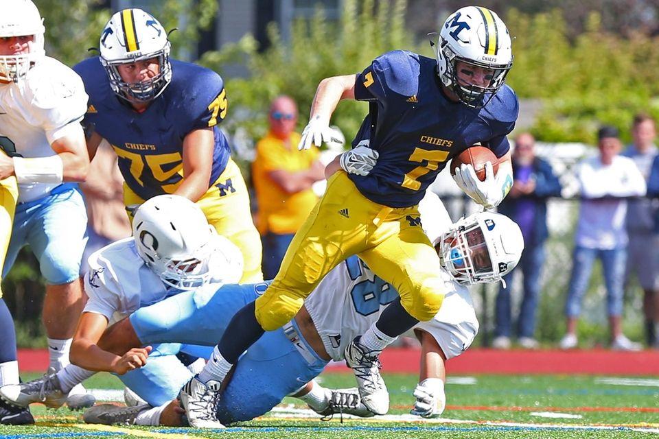 Garrett Gibbons #7 of Massapequa battles for the