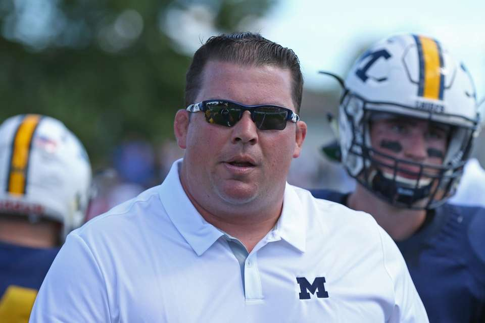 Massapequa head coach Kevin Shippos looks on during
