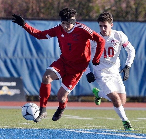 Amityville's Oscar Hernandez controls the ball during a