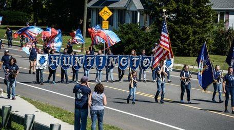 The Huntington High School band marches down Oakwood