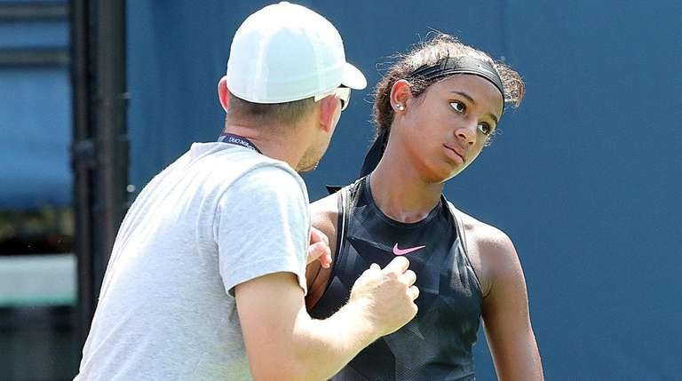 Whitney Osulgwe gets some advice from coach Eric