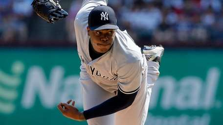 Yankees reliever Aroldis Chapman delivers during a game