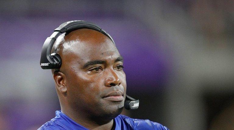 Giants wide receivers coach Adam Henry looks