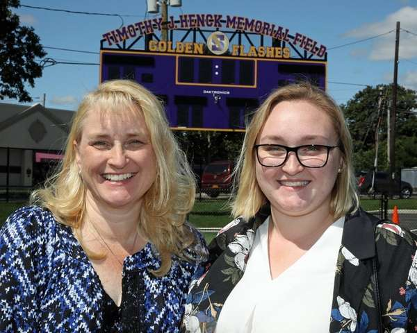 Kathy Henck, left, widow of fallen Suffolk County
