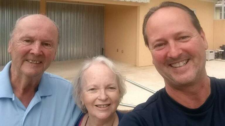 John Cronin of East Northport, with his parents,