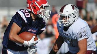 Benny Orlando of MacArthur races downfield during a