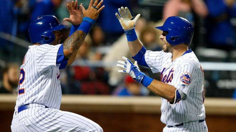 Mets catcher Kevin Plawecki celebrates his two-run home
