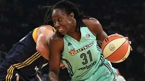 Liberty center Tina Charles drives the ball past