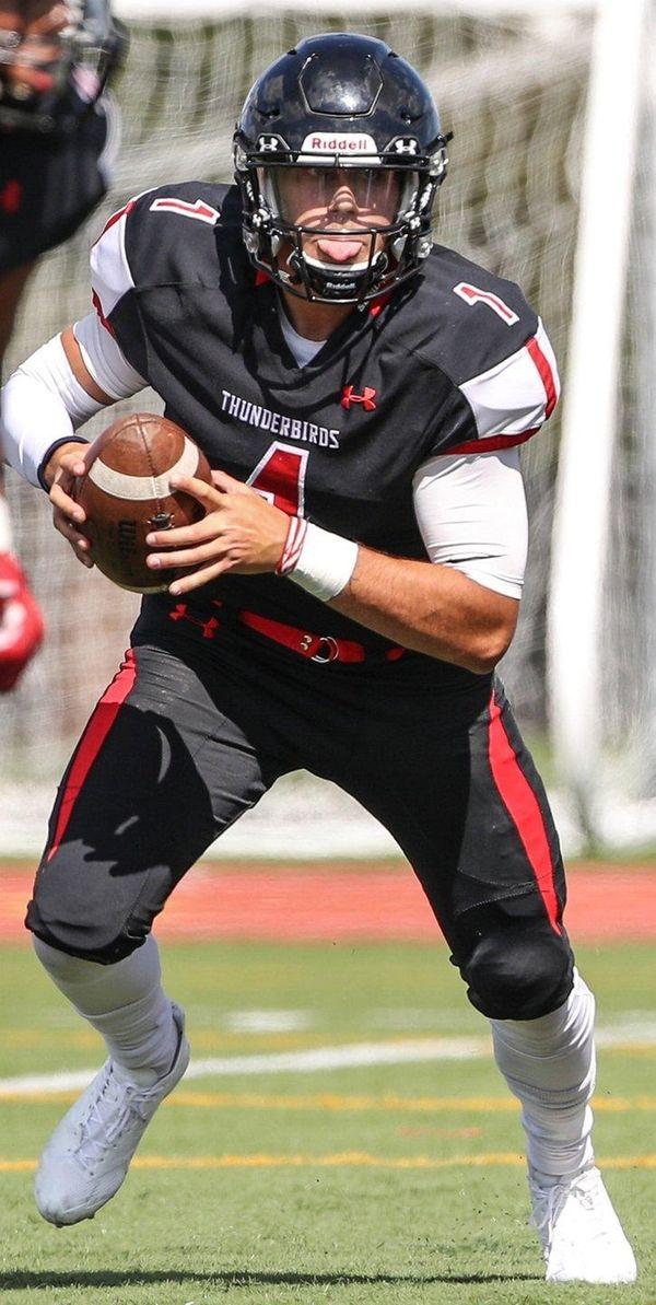 Half Hollow Hills East quarterback Jason Spinelli runs