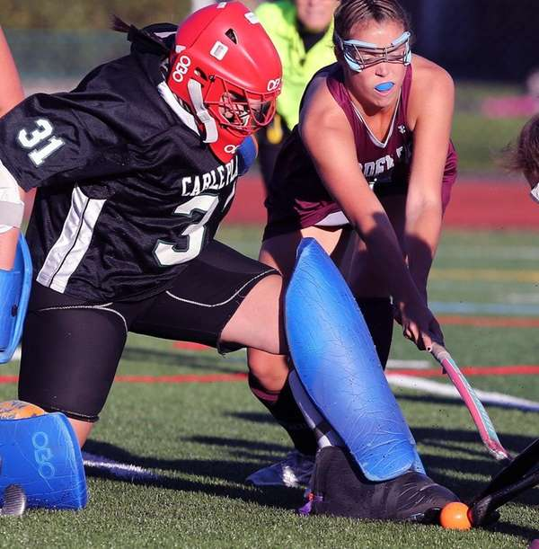 Carle Place  keeper Megan McGuinness makes a save