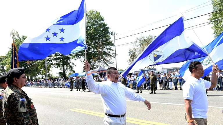 Participants march in the Central American Independence Day