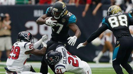 Leonard Fournette of the Jacksonville Jaguars runs through