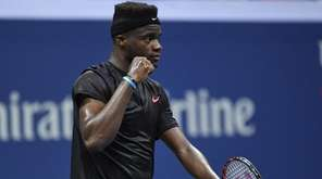 Frances Tiafoe reacts after he wins the fourth