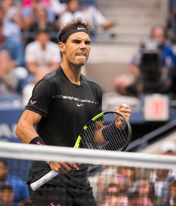 Rafael Nadal pumps his fist after winning the