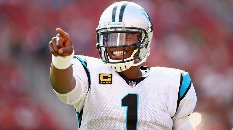 Cam Newton of the Carolina Panthers points to