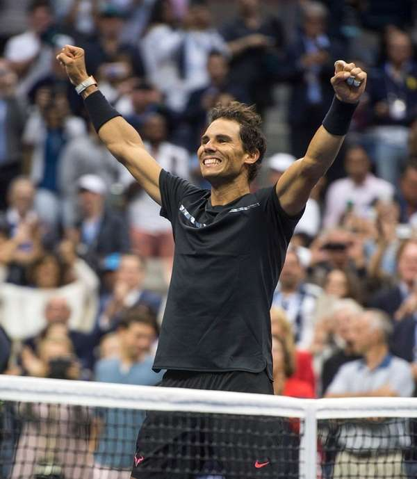 Rafael Nadal reacts after defeating Kevin Anderson inthe