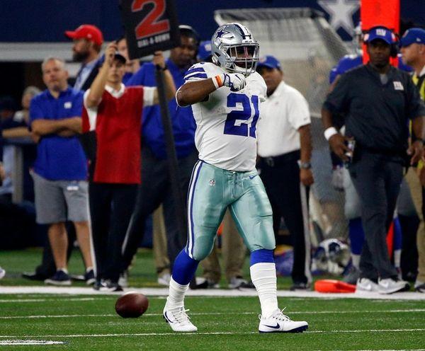 Cowboys running back Ezekiel Elliott gestures after a
