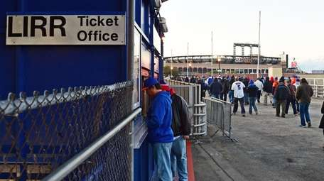 Baseball fans walk from the Mets-Willets Point LIRR