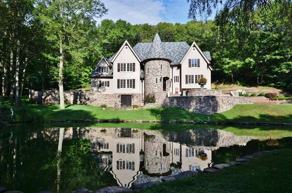 The five-bedroom, 3 ½-bath, 5,000-square-foot French Normandy-style home