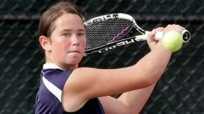 Eastport-South Manor's Jackie Bukzin makes a backhand return