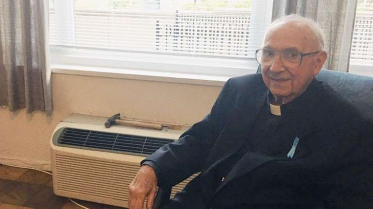 NYPD Chaplain Monsignor Joseph Zammit rests at St.
