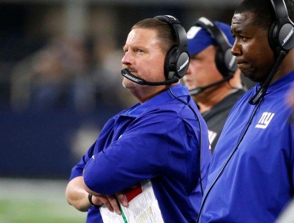 Giants head coach Ben McAdoo watches play in