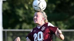 North Shore's Isabelle Glennon heads the ball during