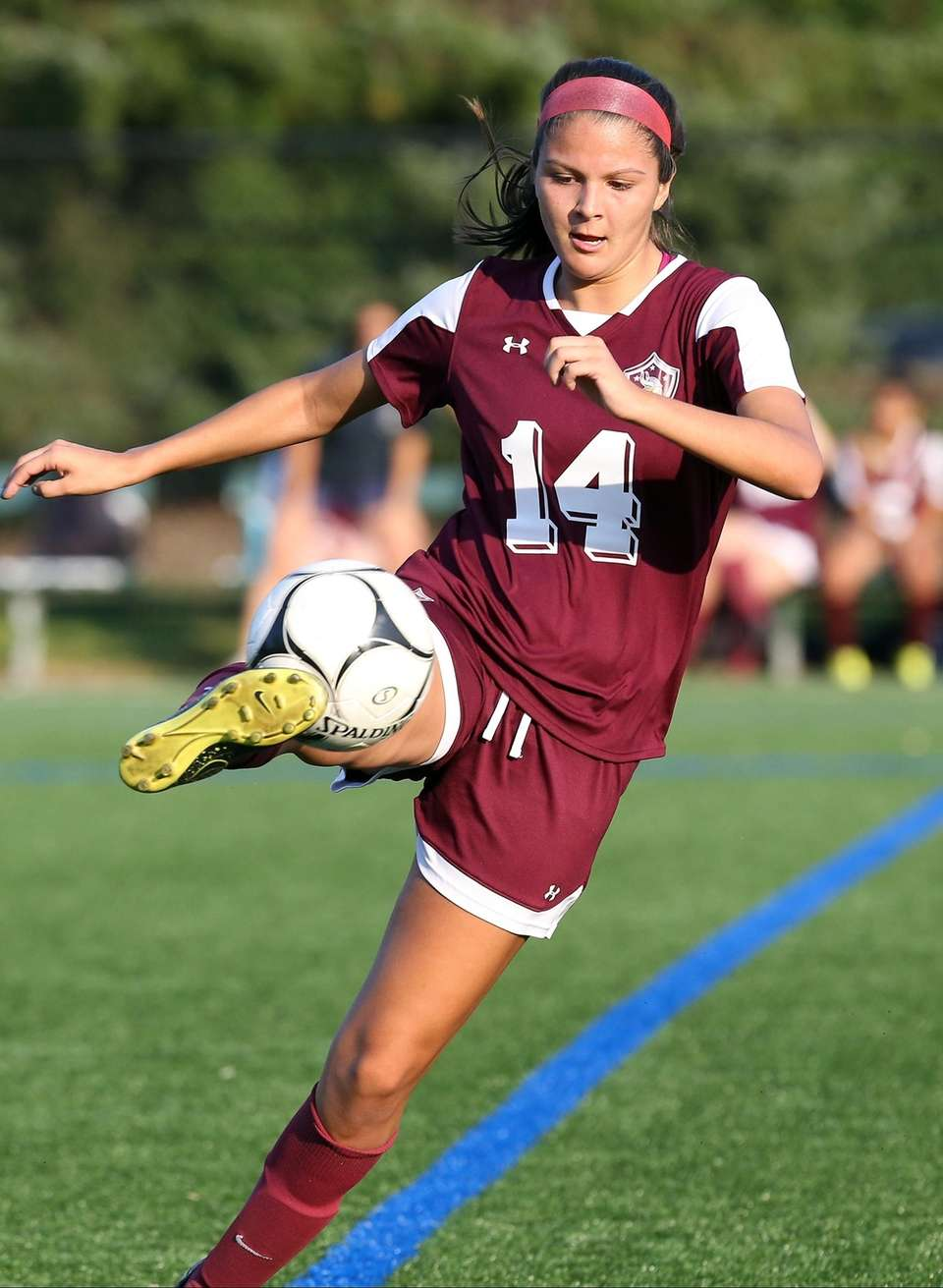 North Shore's Selena Fortich sends it back upfield