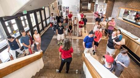 Cate Costanzo gives high schoolers a tour of