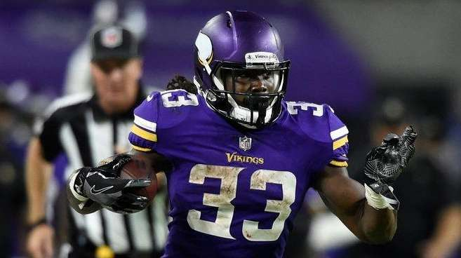Dalvin Cook of the Vikings carries the ball