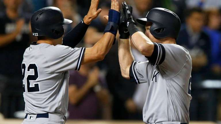 Todd Frazier of the Yankees celebrates his home