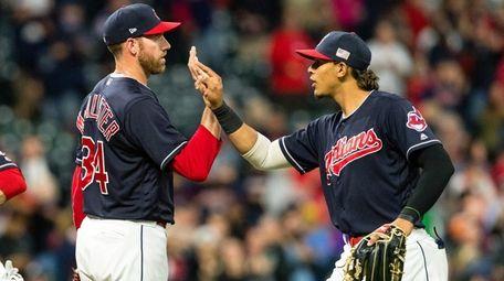 Indians closer Zach McAllister celebrates with Erik Gonzalez