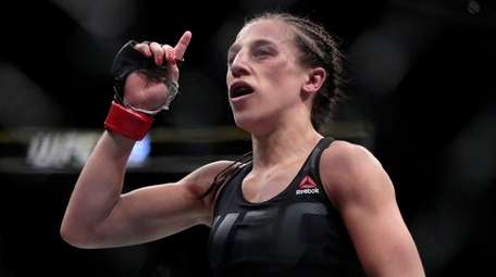 Joanna Jedrzejczyk reacts at the end of her