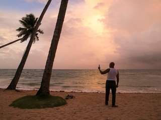 A man stands on the beach in Las