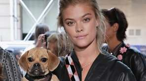Nina Agdal and her puggle Daisy attend the