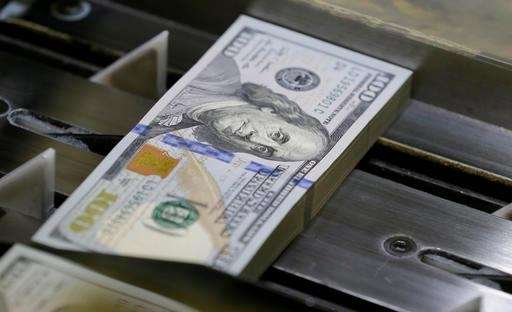 A just-cut stack of $100 bills at the
