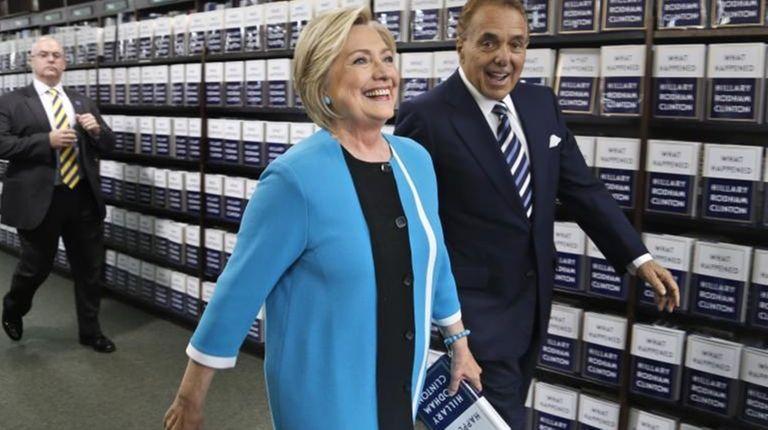 Hillary Clinton, escorted by Leonard Riggio, chairman of
