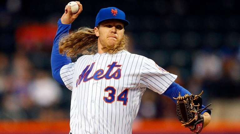 Noah Syndergaard of the Mets pitches in the