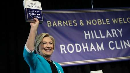 Hillary Clinton with her new memoir,