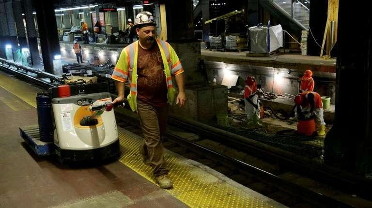 Workers replace rails, ties and concrete on Track
